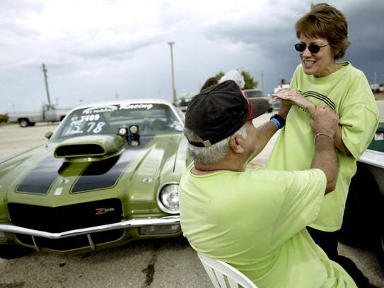Despite losing a drag race to her husband, George Taylor, Betty Taylor shows him who is boss by giving him some beans after the two raced their Camaros on their 40th anniversary July 16, 2005, at the San Angelo Raceway in Wall. Betty Taylor said the beans were representative of the way wedding cake is fed between husband and wife.