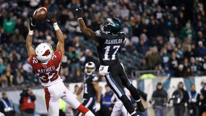 Arizona Cardinals safety Tyrann Mathieu, left, breaks up a pass intended for Philadelphia Eagles receiver Nelson Agholor during the second half of their Week 15 game.