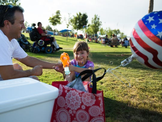 Emmilia Galindo, 6, and her father Andres Galindo play