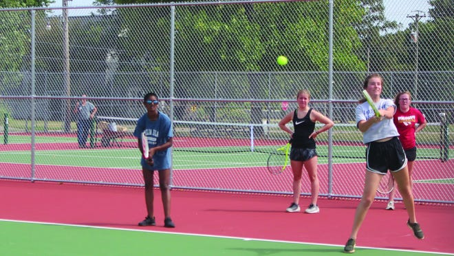 Members of the Macomb High girls tennis team participate in the first day of practice last August.