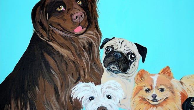 A photograph showing a pet painted on a mural. The mural was created by artist Hannah Eberle, 26, of Kings Beach, Calif., as way to raise money to help pay for the construction of The Biggest Little Dog Park in downtown Reno.