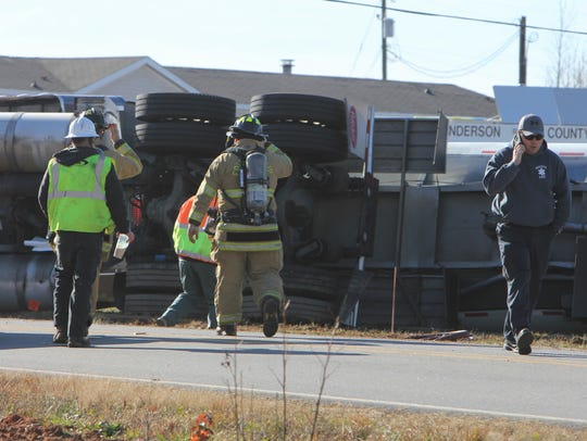 Authorities work to clean up a fuel tanker that overturned
