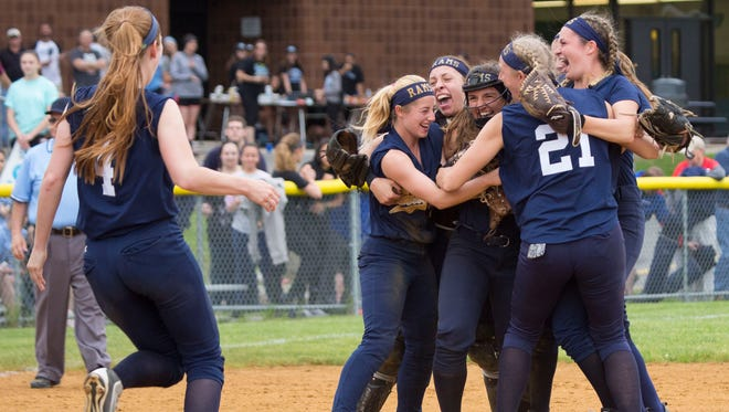 Ramsey softball teammates surround pitcher Victoria Sebastian after winning the county softball championship game against Immaculate Conception at Mahwah on Saturday, May 27, 2017.