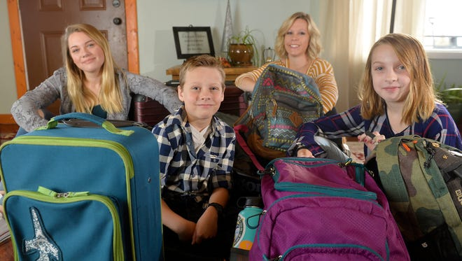 Corrina Dahlin often travels with her kids Ashlyn, age 18, Lincoln, age 9, and Abigail, age 10.