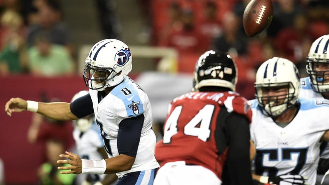 Titans quarterback Marcus Mariota (8) fumbles as he tries to throw a pass during the first quarter Friday.