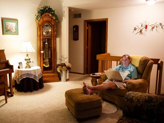 Harlan Kreider works on his computer at his home on