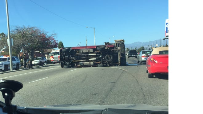 A truck flipped on its side around 4:25 p.m. on Oxnard Boulevard, spilling fuel and fluid onto the street.
