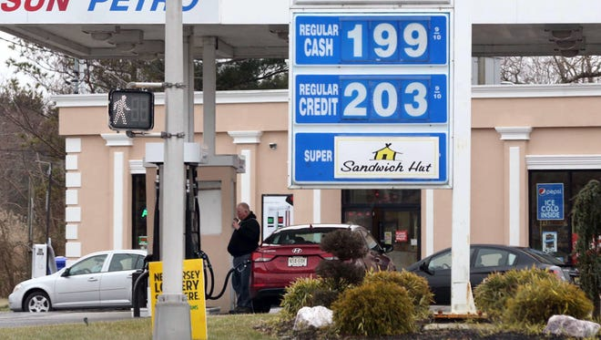 The cash price of regular unleaded gas in Absecon, N.J.,  was below $2 a gallon on Jan. 14, 2015. (AP Photo/The Press of Atlantic City, Vernon Ogrodnek)