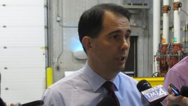 Gov. Scott Walker speaks to reporters in Madison, Wis. on Thursday, June 26, 2014. On Thursday, an attorney for the special prosecutor leading an investigation into alleged campaign law violations said no conclusions have been made on whether there's enough evidence to charge Walker or anyone else with a crime. (AP Photo/Scott Bauer)