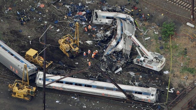 In this file aerial photo, emergency personnel work at the scene of a deadly train wreck May 12, 2015 in Philadelphia. (AP Photo/Patrick Semansky)