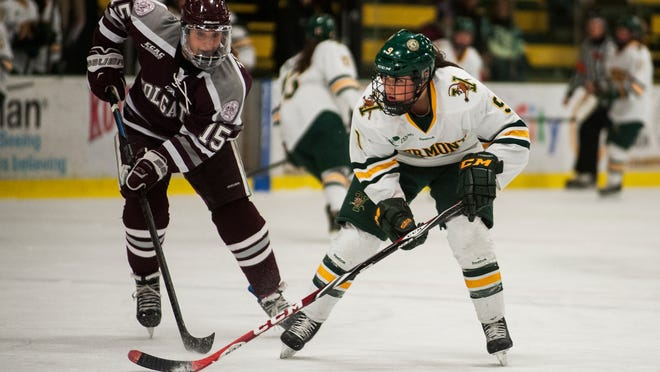 Catamounts forward Dayna Colang, right, skates past Colgate's Annika Zalewski with the puck during the women's hockey game earlier this season.