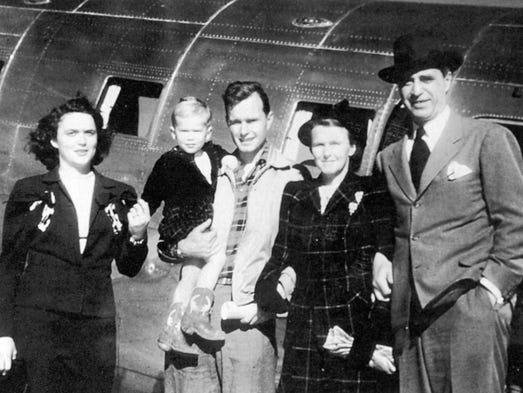 George H.W. Bush, holding George W. Bush, along  Barbara
