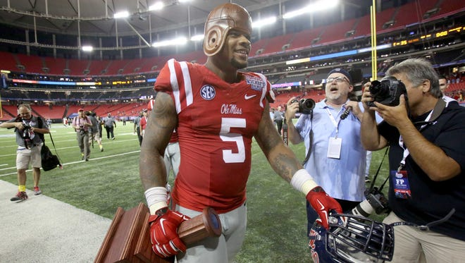 Former Ole Miss defensive tackle Robert Nkemdiche walks off the field following the team's 35-13 victory over the Boise State last season. He helped the Rebels reach the Sugar Bowl this season but won't play.