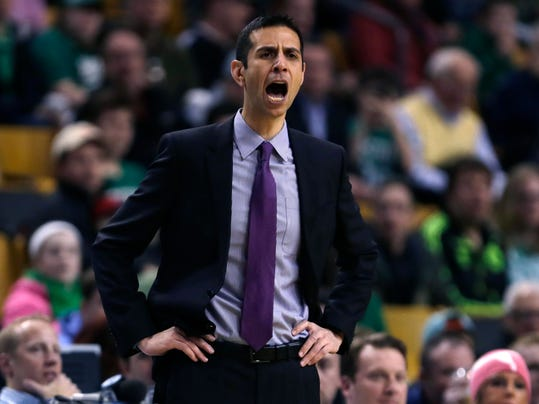 Orlando Magic head coach James Borrego calls to his players during the first quarter of an NBA basketball game against the Boston Celtics in Boston, Friday, March 13, 2015. (AP Photo/Charles Krupa)