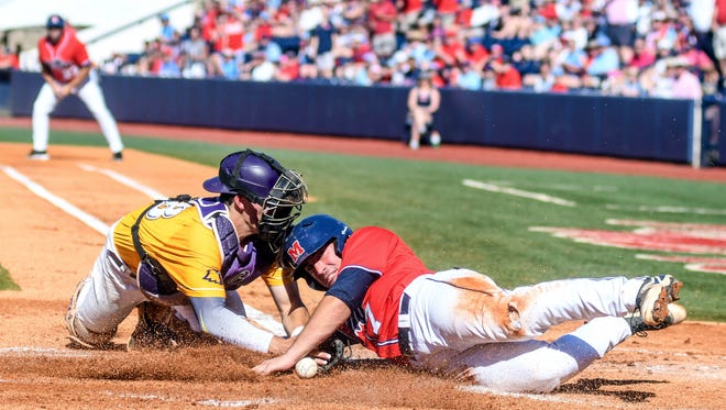 Mississippi's Nick Fortes (7) is safe as the ball gets away from Tennessee Tech catcher Brennon Kaleiwahea (28) in the NCAA college baseball Oxford Regional in Oxford, Miss., Sunday, June 3, 2018. (Bruce Newman/The Oxford Eagle via AP)