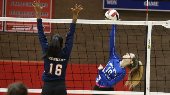 Maria Regina's Gia Riordan (10) hits a shot as Kennedy Catholic's Kristen Quarless (16) works a block during the CHSAA volleyball championship match at Kennedy Catholic High School in Somers on Thursday, November 2, 2017.