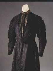 The beautiful black silk dress currently on display in Susan B. Anthony's bedroom.