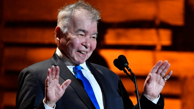 John Prine acknowledges the crowd's standing ovation at the Americana Music Honors & Awards on Wednesday, Sept. 13, 2017, at the Ryman Auditorium in Nashville.