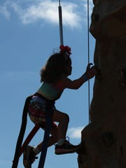 Callie Schoenick, 6, of Wisconsin Rapids hangs from
