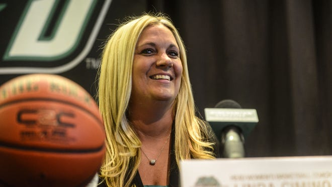 Binghamton University women's basketball coach Linda Cimino listens to Director of Athletics Patrick Elliott's introduction during a press conference to formally announce her hiring in the Events Center in April 2014.