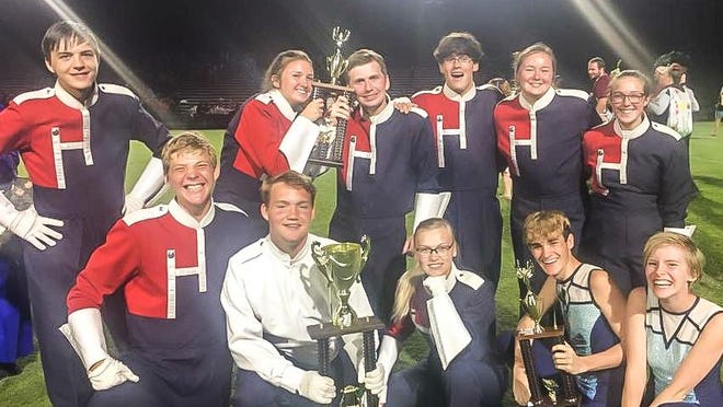 Members of the White House Heritage High School Marching Band celebrate the awards and accomplishments they received during their fall season.