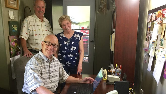 Jim Ahrens, seated, is joined by Ellis and Virginia Misner, in welcoming new broadband service to the area after a long struggle.