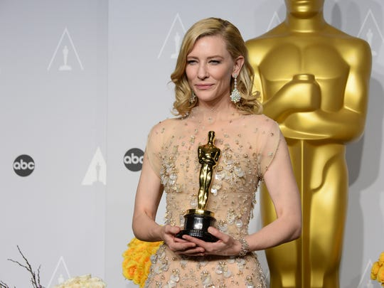 "Cate Blanchett poses with the award for best actress in a leading role for ""Blue Jasmine"" during the Oscars on Sunday, March 2, 2014, in Los Angeles."