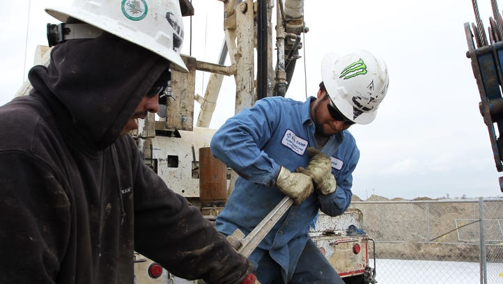 Workers drill for water for a farmer near Bakersfield