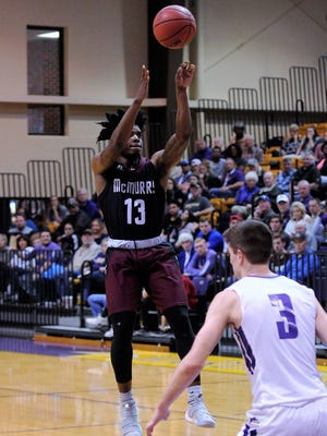 McMurry guard Zacc Carter (13) takes a 3-point shot during the War Hawks' 90-84 loss to Hardin-Simmons at the Mabee Complex on Saturday, Feb. 17, 2018.