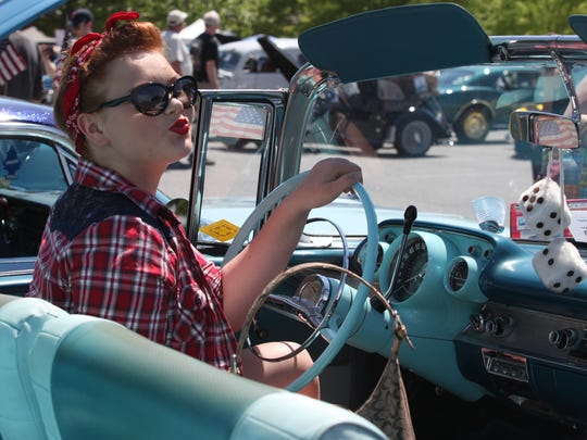 Christina Bello, of New Castle, sits behind the wheel of a 1957 Chevrolet at a Wilmo a Go-Go event in Wilmington. The seventh annual car show and festival will be held Sunday.