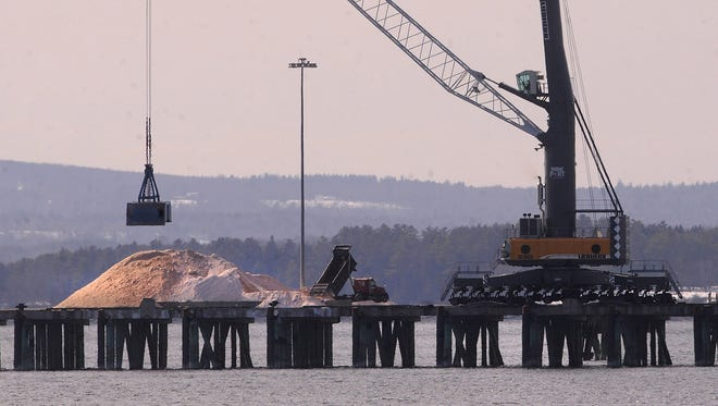 Tons of rock salt sits piled up in Searsport, Maine, Tuesday awaiting the arrival of a barge to bring it down to New Jersey.