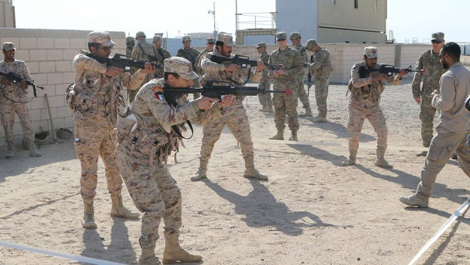 2nd Brigade soldiers train with members of the Kuwaiti Land Forces. Soldiers from 1st Battalion, 35th Armored Regiment show an array of skills from clearing rooms and urban defense to squad attacks.