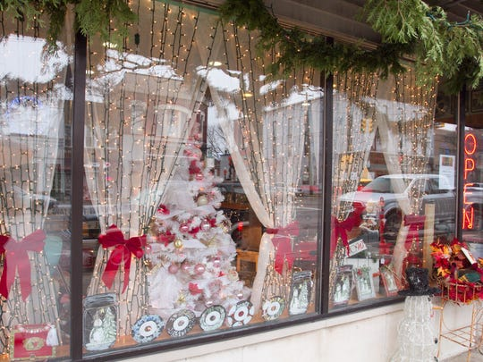 The Roost & Company's window in downtown Howell is
