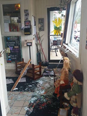 Shards of glass were sprawled throughout the floor of Sandy's Cozy Corner after a car crashed into the front of the restaurant Saturday morning.