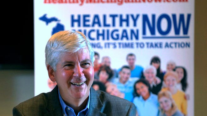 Michigan Gov. Rick Snyder talks to the media after the Michigan House of Representatives passed the Medicaid expansion bill on Sept. 3, 2013.