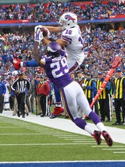 Bills Chris Hogan makes a big catch at the 2-yard line in front Vikings defender Xavier Rhodes during the 2014 season.