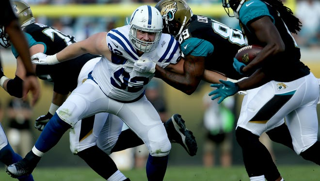 Indianapolis Colts outside linebacker Bjoern Werner (92) is held by Jacksonville Jaguars tight end Marcedes Lewis (89) in the second quarter of their game at EverBank Field Sunday, December 13, 2015, afternoon  in Jacksonville FL.