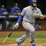 Kansas City's Mike Moustakas hits a RBI-double off Tampa Bay Rays starter Jake Odorizzi during the fourth inning Saturday in St. Petersburg, Fla. The Royals won 6-3.