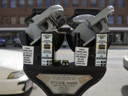 Downtown Great Falls parking meters being serviced in 2014.