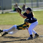 Great Falls High second baseman Marihelen Held takes a pickoff throw at second base as Katie Heryla dives back to the base during a crosstown game last season.