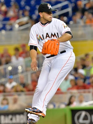 Miami Marlins starting pitcher Jose Fernandez (16) delivers a pitch against the Cincinnati Reds during the first inning at Marlins Park.