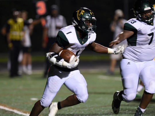 Groves senior Chaise Ford scored the game-deciding two-point conversion in the third overtime to lift the Falcons past Harrison, 32-31.