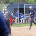 Granville's Shelby Sprouse is met at the plate by her teammates to celebrate her 2-run homer in the third inning against Lakewood. The Blue Aces defeated the Lancers 9-7 on Friday.