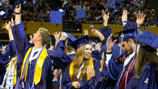 Elizabeth Day, center, and fellow Higley High school students celebrate during graduation at ASU Wells Fargo Arena in Tempe on  May 24, 2018.