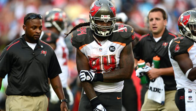 Tampa Bay Buccaneers defensive end Adrian Clayborn walks off the field during a Week 1 game against Carolina after suffering a torn biceps.