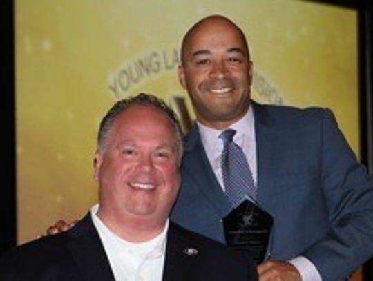Photo attached: Damon Elmore (right) accepts congratulations