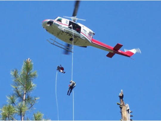 Fire teams rappel down to the Chetco Bar Fire