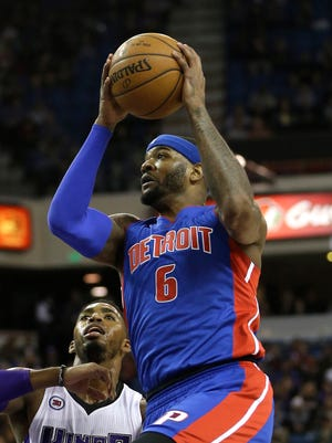 Detroit Pistons forward Josh Smith, right, drives to the basket against Sacramento Kings  forward Jason Thompson on Dec. 13, 2014.