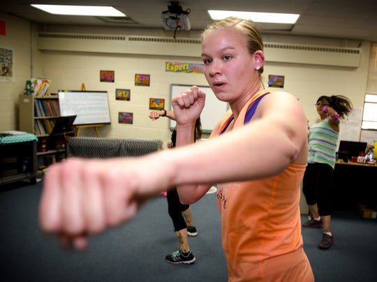 East Picacho Elementary kindergarten and first grade teacher Jessica King works out during a staff kickboxing class.