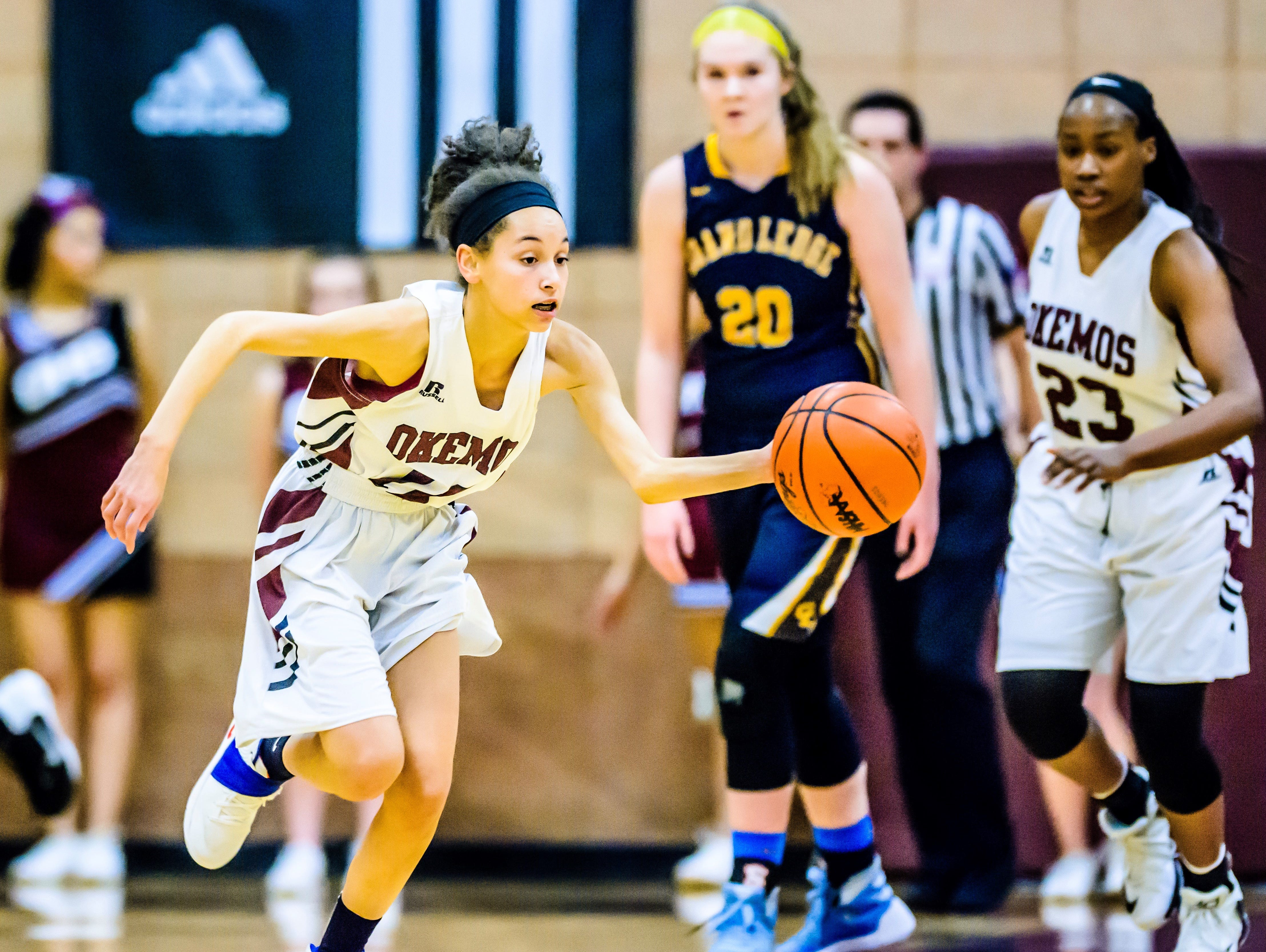 Kelsey Henry of Okemos pushes the ball to the Grand Ledge basket after stealing it during their game Friday February 3, 2017 in Okemos.